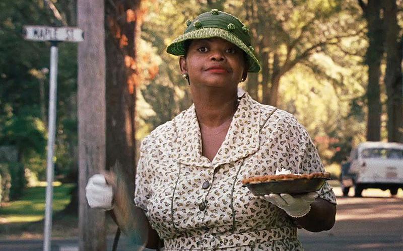 """Minny Jackson, personagem interpretada por Octavia Spencer no filme """" Histórias Cruzadas"""""""