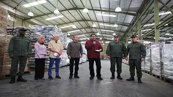 Maduro em um Centro de Empacotamento de Alimentos para os Comitês Locais de Abastecimento e Produção (CEAC)