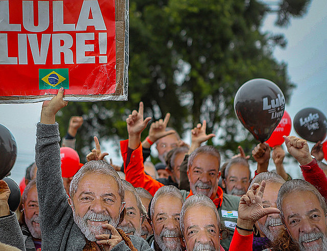 Supporters wear Lula masks at the Free Lula Vigil in Curitiba, where a camp was set up to demand the ex-president's release