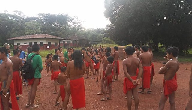 Fearing armed attack, indigenous villagers fled from their homes to nearby Aramirã