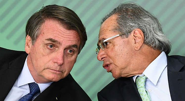 Bolsonaro (esq.) e o ex-banqueiro Paulo Guedes (dir.), ministro da Economia