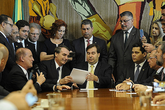 President Bolsonaro hands over proposed pension reform to the president of Brazil's lower house, Rodrigo Maia