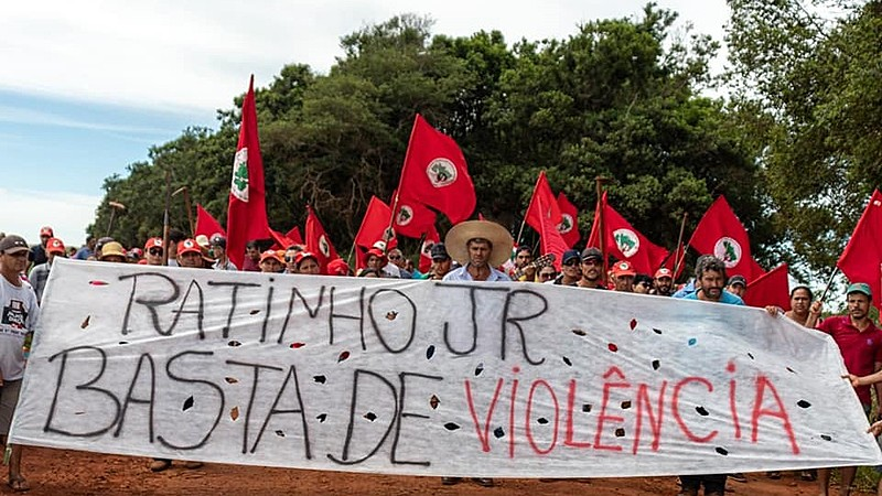 "Landless demonstrators hold banner that reads, ""Ratinho Jr., no more violence,"" calling out Paraná governor"