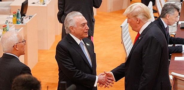 Brazilian President Michel Temer greets U.S. President Donald Trump