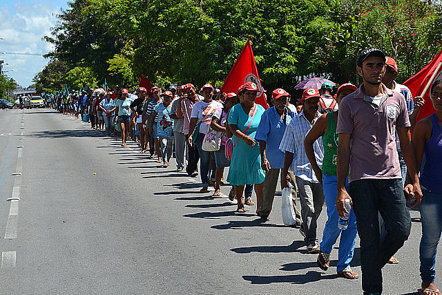 Landless workers march in protest for land reform in 2015