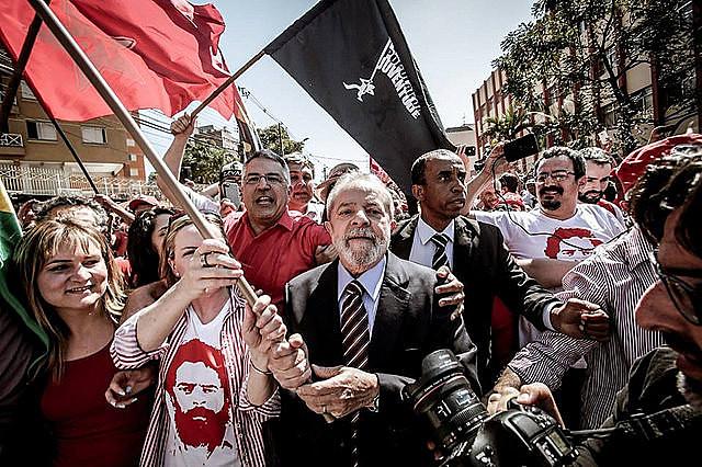 Luiz Inácio da Lula is met by his supporters in the city of Curitiba.