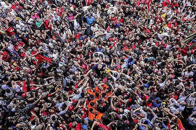 Lula is carried on the shoulders of supporters in São Bernardo do Campo before turning himself in to the Federal Police